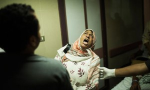 Egyptian woman reacts as she sees wounded son in Cairo